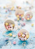 Chocolate mini eggs in egg shells