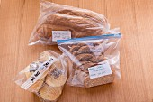 Bread and bread roll portions in plastic bags