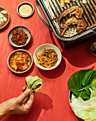 Samgyeopsal gui - grilled pork belly in a lettuce leaf, Korea
