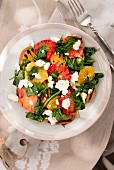 Warm spinach salad with orange, grilled sweet potato and feta