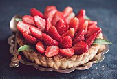 A homemade tart with vanilla pudding and strawberries