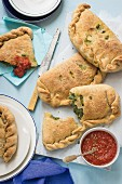 Spinach and ricotta calzone with tomato sauce