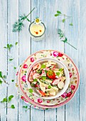 Chicken salad with radishes, green beans and strawberries