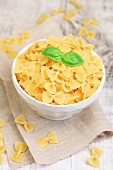 Farfalle pasta in a bowl with fresh basil