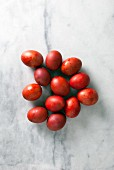 Red Greek Easter eggs on a marble background
