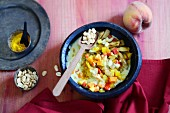 Lupine and peanut curry with fresh peaches