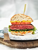 A beefburger with a skewer through it