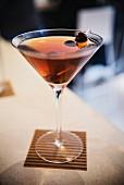 Rye Manhattan with cherries soaked in brandy