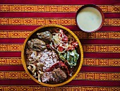 Red rice, beef, buckwheat dumplings and Ema Datshi (Bhutan)