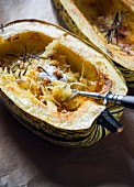 Baked spaghetti pumpkins with walnuts, thyme and vegan cream fraiche