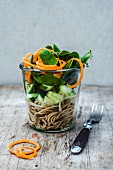 Spaghetti with cucumber and spinach in a glass