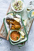 Fish nuggets with a mango and banana dip