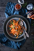 Carrot salad with spring onions, hazelnuts and tarragon