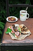 A whole grain sandwich with lamb's lettuce, roasted duck breast and wild mushrooms