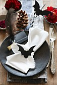 Halloween table decorated with hand-made paper bats