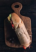 Served submarine sandwich on wooden board