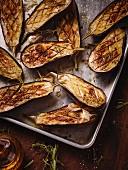 Baked aubergines on baking tray