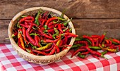 Fresh chillies in a wicker basket at a market