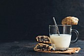Stuffed homemade chocolate chip cookies and a glass of milk