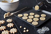 Making biscuits on a baking sheet with a dough press