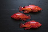 Fresh strawberry groupers on a black background