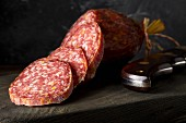 Beef salami slices on a wooden board