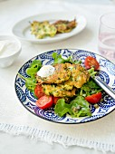 Zucchini fritters with spinach and tomatoes