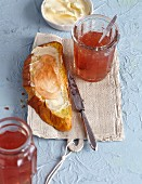 Quince jelly in a glass jar and spread on a slice of bread