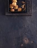 Walnuts on a dark background