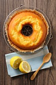 A ring-shaped lemon cake on a cooling rack