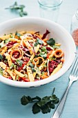 A vegetable salad with radicchio, carrots, mango and chilli