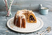 Carrot-Gugelhupf with fresh cheese-chocolate filling and lemon-glaze