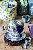 Ice cream with black sesame in a flowered cup