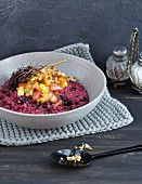 Elderberry and pearl barely risotto with baked apples