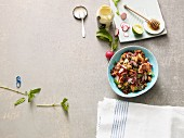 Superfood salad with quinoa, papaya and radishes