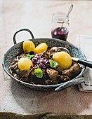 Venison goulash with elderberries and potatoes