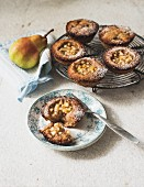 Linzer tartlets with pear chunks and quince jelly