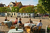 Guests at a street café in the city centre of Odense, Funen, Denmark