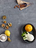 Lemon, physalis, almonds, orange, and fennel
