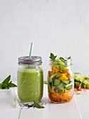 A green smoothie and a vegetable salad