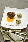 A rosemary roasted veal fillet with parsley cream and pumpkin sauce