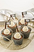 Chocolate cupcakes with whipped cream and small labels