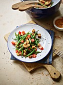 A green bean salad with sweet potatoes, smoked tofu and vegan mayo
