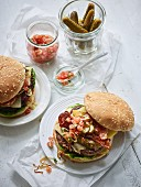 Burgers with bacon, tomato salsa, and gherkins