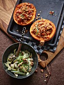 Stuffed pumpkins with a zucchini and nut salad