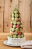 A Christmas pyramid cake made of pistachio and redcurrant macarons