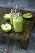 A perfect green smoothie with wheatgrass, lettuce, apple and banana