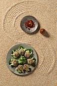 Quinoa pralines with bean sprouts and an avocado dip