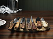 Various kitchen knives on a wooden board
