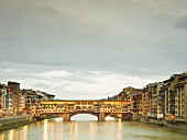 The Ponte Vecchio bridge over the Arno River in Florence, Tuscany, Italy